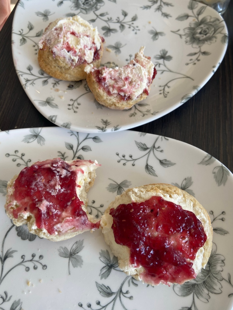 Scones, cream and jam. One scone has cream first and jam second, and the other has the opposite.
