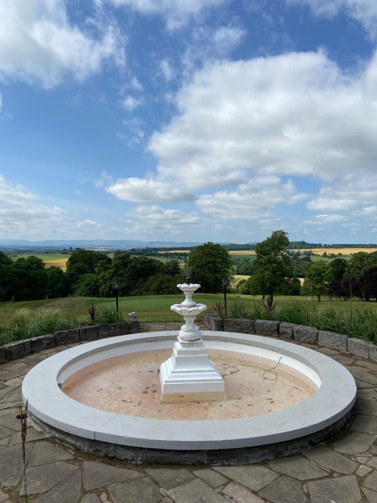 A white water fountain with views over the golf course.
